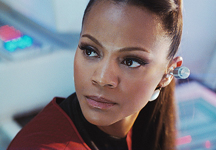In the new movie Uhura is in a romantic relationship with which other character?