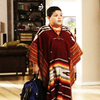 Ep: Run For Your Wife- What does Jay say Manny's poncho looks like?
