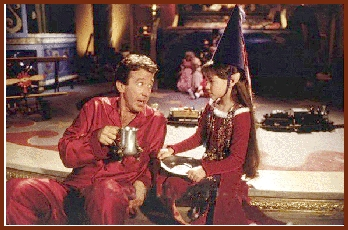 in santa clause movie: what is  S.C. as tim allen's real character's name as santa claus ?