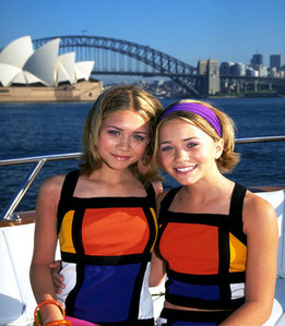 "In the filming of ""Our lips are sealed"" what was the real reason why they had to quickly climb back down from the top of the Sydney Harbour Bridge ?"