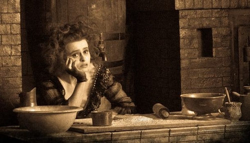 What kind of drink does Mrs.Lovett offer to Sweeney in the song Worst Pies in London?
