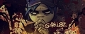 In the Gorillaz video 'Rockit', what did the zombie head speech bubble say the 2nd time?