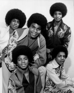 Which record label did the J5 first sign?