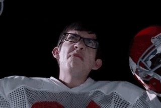 What number is Artie's jersey on the football team?