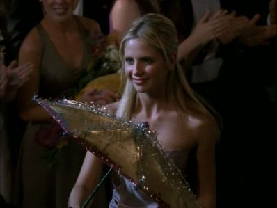"In the episode ""Homecoming"" where Buffy was running for Prom Queen, who was with her when she was on her way to prom and got attacked?"