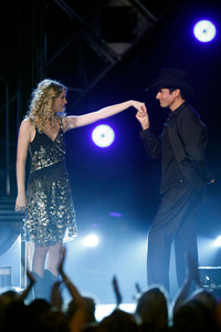 At the 2009 ACM Awards, Taylor assisted magician David Copperfield with two illusions. In the first, he made her appear inside an empty elevator. What was the second?