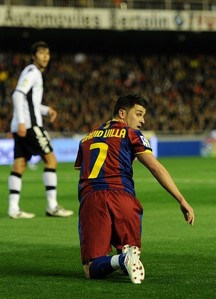 Where did David Villa play before he came to Barcelona?