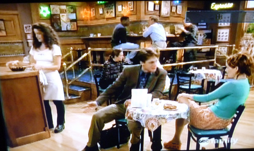 "In the TV mostra , ""Two of a kind"", what is the name of Kevin and Carrie's coffee spot ?"