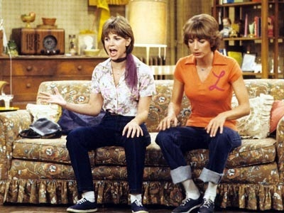 In episode 4 of the first season what are Laverne & Shirley shocked to find out their old friend Anne Marie is?