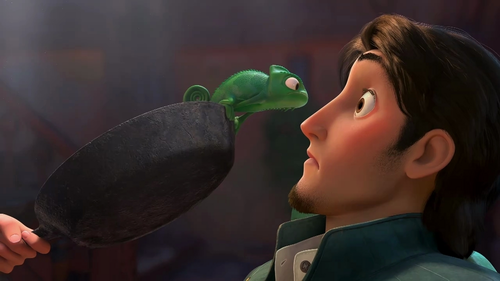 Pascal turns what colour when Flynn and Rapunzel kiss?