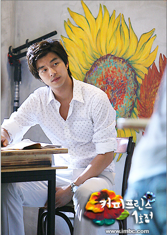 Who painted the flowers on the wall of the Coffee Prince?