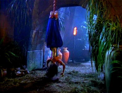 Why did Xena find herself hanging upside down?