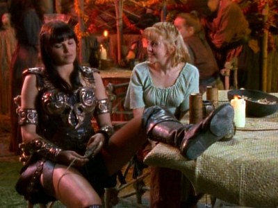 What is Xena holding in Her hands?