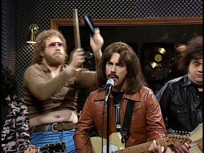 "What early-metal band does Gene Frenkle play cowbell in, in the ""More Cowbell"" sketch?"