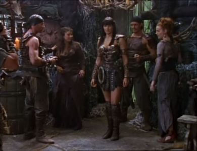 "Which god was the crowd praising at the tavern when Xena came in? (in the episode ""The Path Not Taken"")"