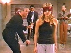 Buffy wore a red blindfold whilst proving herself to watchers council in the episode...