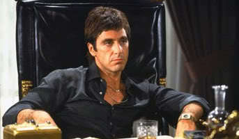 "In ""Scarface"" what is his younger sister's name ?"