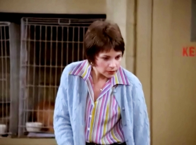 """In the episode entitled """"It's a Dog's Life"""" from season 4, what type of dog does Shirley handcuff herself to?"""