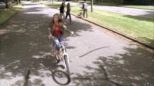 "In the episode ""Rest in Peace"" George's cycling the streets saying that it's a good day. What item then gets stuck in her wheel spokes?"