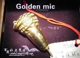 who own this gold microphone?