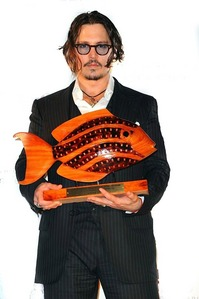 Where has Johnny Depp been awarded this wooden fish?