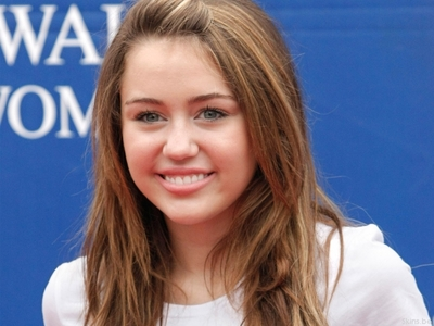 Which caracter Miley provide voice in film 'Bolt'?