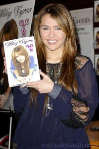When Miley published book 'Miles To Go'?