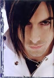What instrument did Ian Watkins used to play for the band?