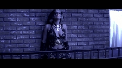 Who designed this outfit from The Edge of Glory video?