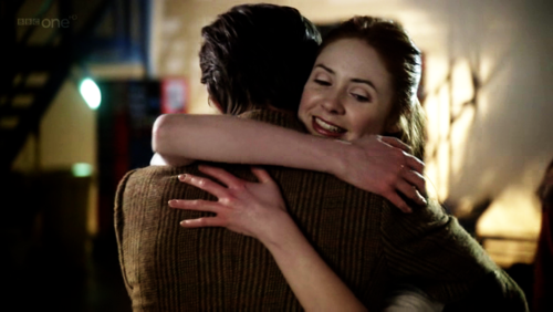 What did the Doctor ask Rory just before he hugged Amy?