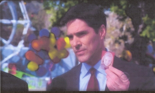 Whose photo is Hotch holding?