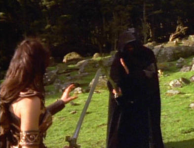 "At the start of ""The Reckoning"" Xena fought off a mysterious hooded man to keep him from killing the villagers. What was his actual name?"