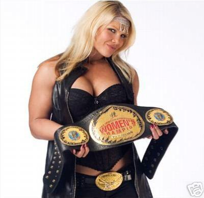 Who did Beth Phoenix defeat to win her first WWE Women&#39;s Championship?