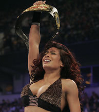 Who did Melina defeat to win her first WWE Women's Championship?