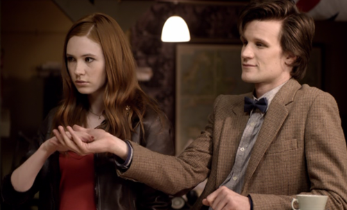 What is Amy handing over to the Doctor?