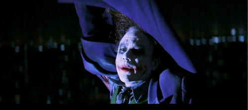 At the end when 배트맨 throws the joker off of the buildng and catches him and pulls him up what does the joker say?