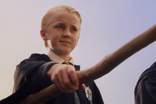 In second year, what broom did Draco and the Slytherin quidditch team get?