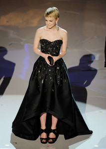 Who designed the dress she wore to the 2010 Academy Awards?