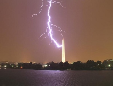 The Washington Monument is topped with a tiny tip/lightning rod made of __________ .