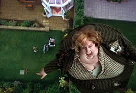 HP3:POA:when they are eating dinner with Aunt Marge how many candle sticks are on the table at the Dursleys'?