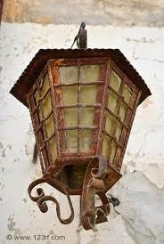 HP1:PS(movie):when Dumbledore places baby Harry on the Dursleys' doorstep; is their porch light on?