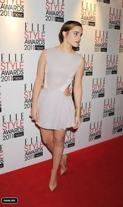 Who designed the dress Emma wore to the 2011 Elle Style Awards?