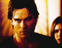 Who is Damon protecting Elena from in this scene?