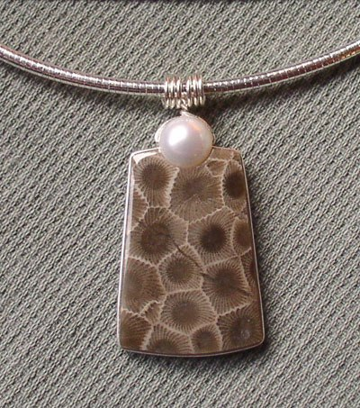 This pendant was made of Pectolite & Pearl.