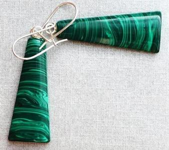 These earrings were made of Emerald.