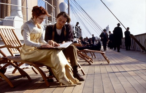 How many pictures do we see that Jack shows Rose that he has done in the scene where they are talking on the boat deck?