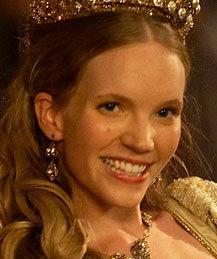 In whose household was Katherine Howard raised?