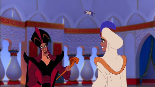 How many Iago's feathers fall when he is chased by Sultan on carpet?