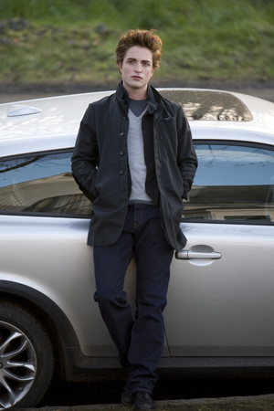 What Debussy song does Bella identify during her first ride in Edward's car?