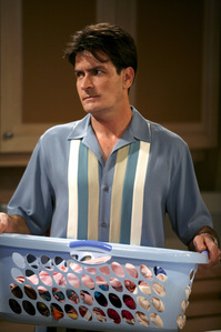 According to Two and a Half Men, what is Charlie's FULL NAME?